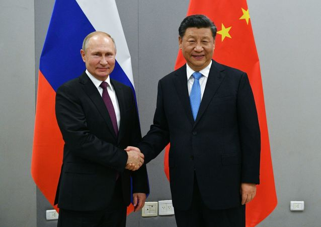 習近平和普京分別向中俄執政黨對話機制第九次會議致賀信