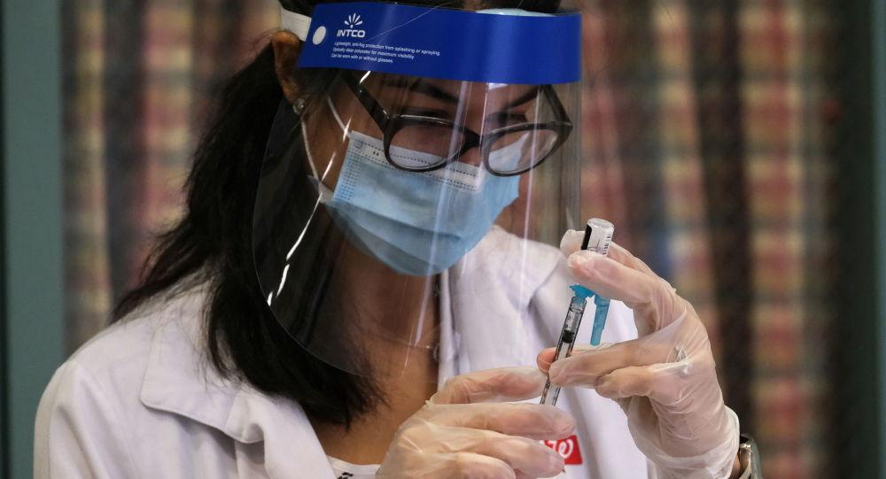 Walgreens Pharmacist Jessica Sahni prepares the coronavirus disease (COVID-19) vaccine at The New Jewish Home, a nursing home facility, in the Manhattan borough of New York City, New York, U.S., December 21, 2020