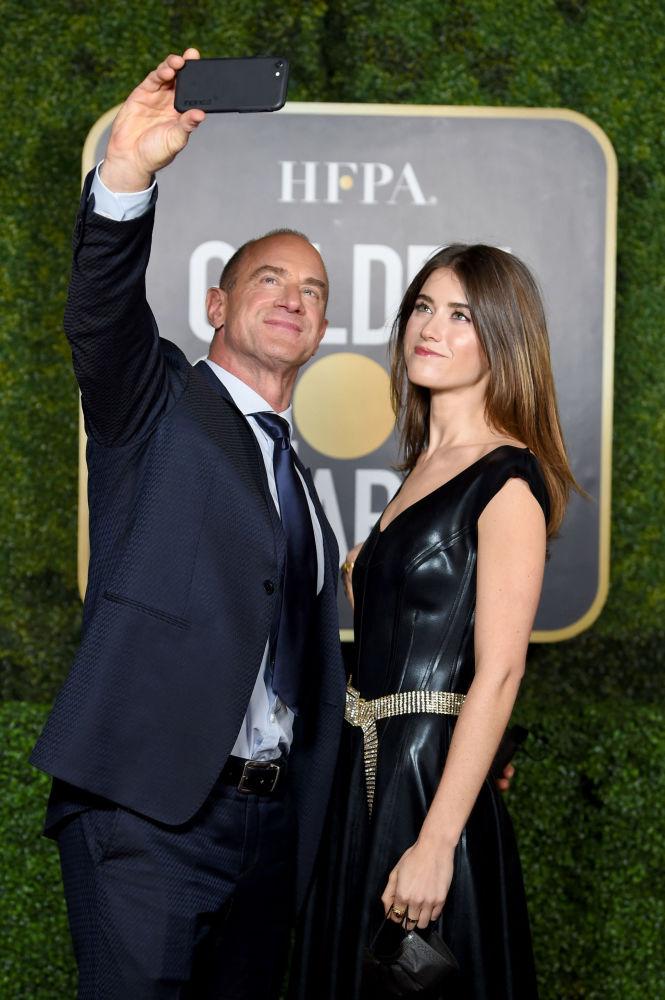 美國演員克里斯托佛·梅洛尼與女兒參加金球獎頒獎典禮當天活動。