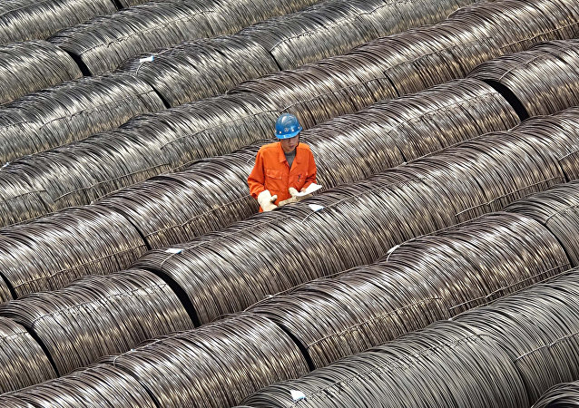 A worker checks steel wires at a warehouse in Dalian, Liaoning province