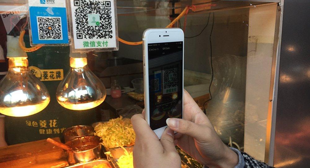 中國許多貿易攤位不再接受作為法定流通貨幣的人民幣現金