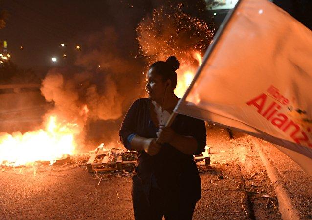 洪都拉斯總統大選失利候選人稱該國反對派將繼續鬥爭