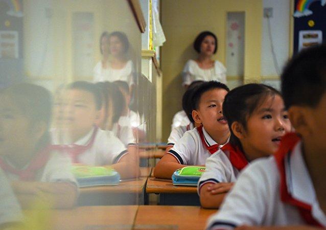 學子叩首:河南一學校因舉行有損自尊的儀式而廣受批評