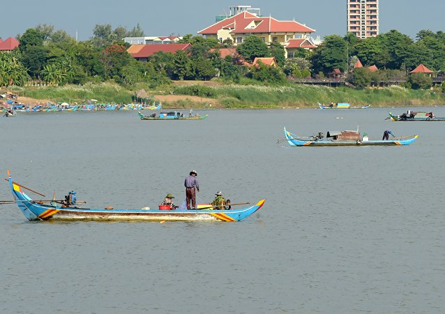 Fishermen pulling their nets in the Mekong river
