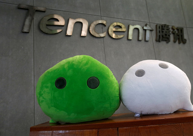 WeChat mascots are displayed inside Tencent office