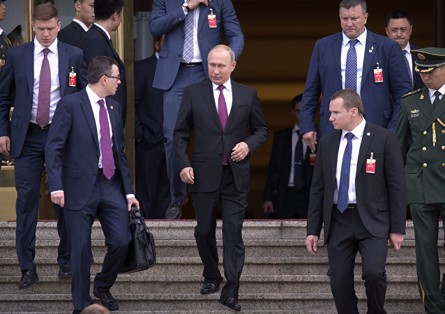 Russian President Vladimir Putin, center, leaves the Great Hall of the People after meeting with Chinese Premier Li Keqiang in Beijing