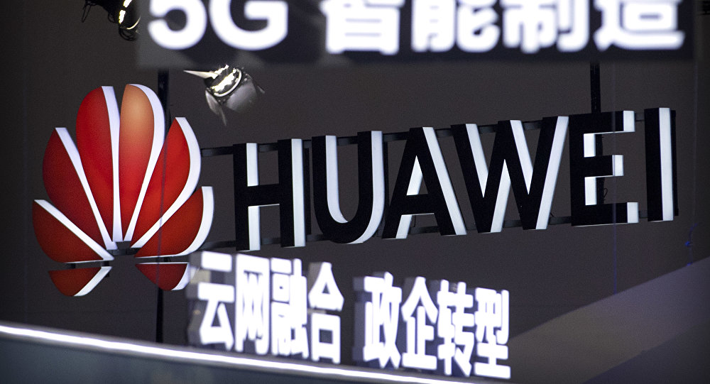Signs promoting 5G wireless technology from Chinese technology firm Huawei are displayed at the PT Expo in Beijing