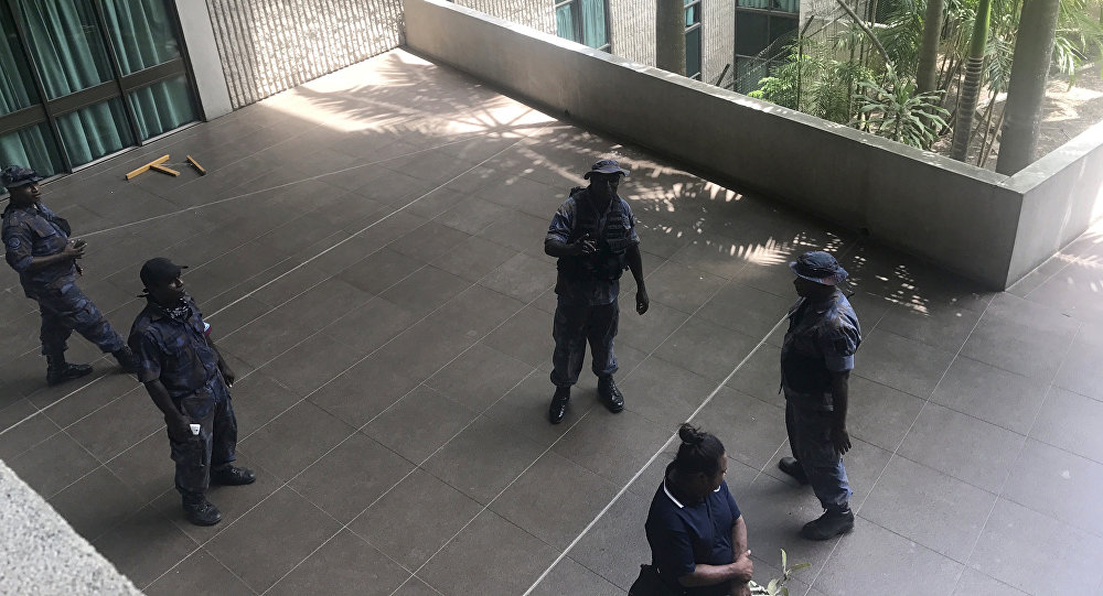 Police and soldiers guard the outside of the Parliament