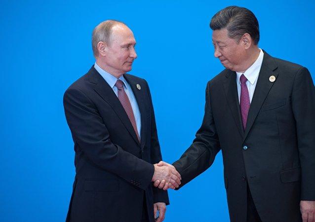 普京稱習近平是世界級政治家