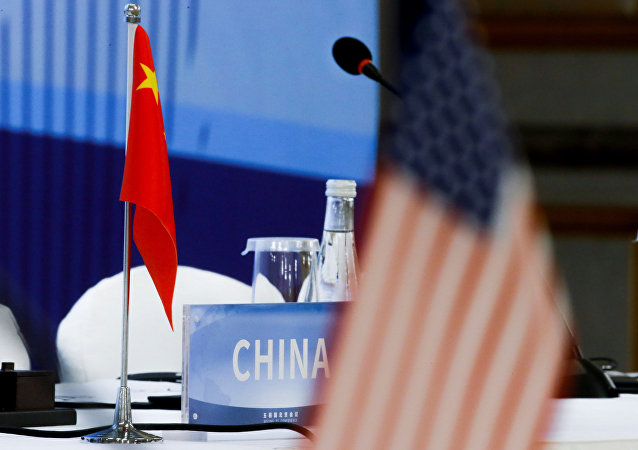 The Chinese and U.S. national flags are seen before the start of a P5 NPT conference in Beijing