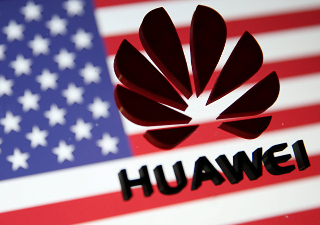 A 3D printed Huawei logo is placed on glass above a displayed U.S. flag in this illustration