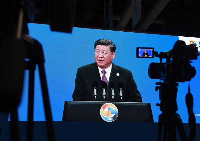 An image of Chinese President Xi Jinping speaking at the opening ceremony of the Belt and Road Forum, is seen in the media center of the Forum in Beijing on April 26, 2019.