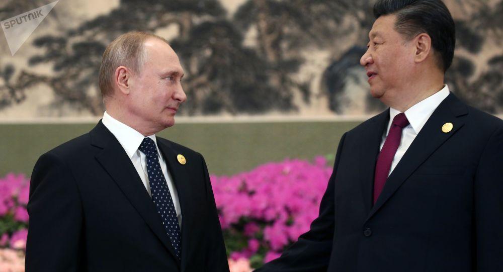 俄羅斯總統普京(左)和中國國家主席習近平