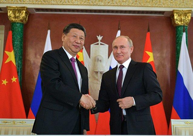 俄羅斯總統弗拉基米爾·普京與中華人民共和國主席習近平