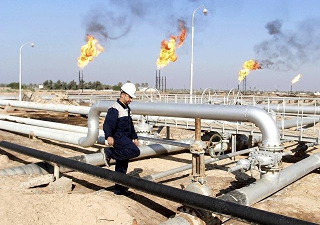 A worker walks at Nahr Bin Umar oil field, north of Basra, Iraq December 21, 2015