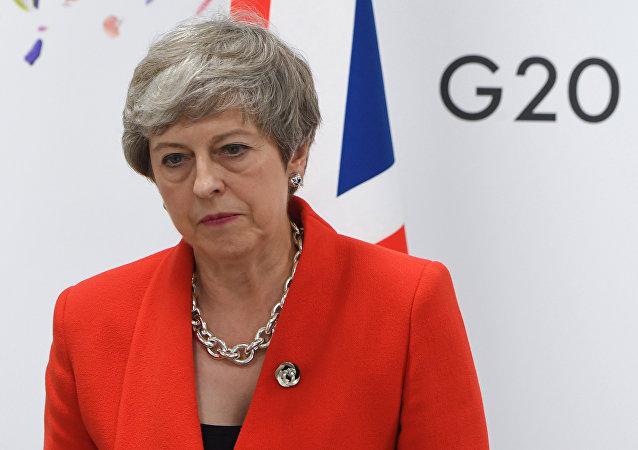 Премьер-министр Великобритании Тереза Мэй во время встречи с президентом РФ Владимиром Путиным на полях саммита Группы двадцати в Осаке.