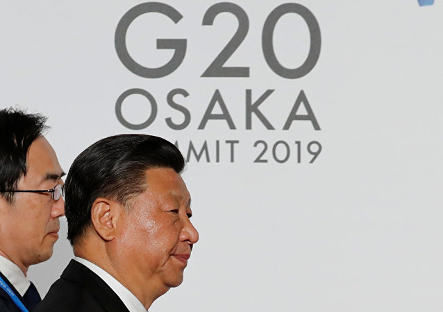 Chinese President Xi Jinping arrives for an welcome and family photo session at G20 leaders summit in Osaka, Japan