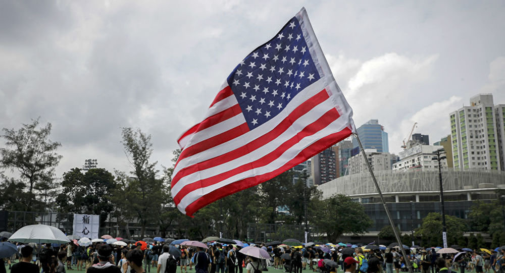 A US flag flutters as people gather at Victoria Park to take part in an anti-extradition bill protest in Hong Kong, 11 August 2019.