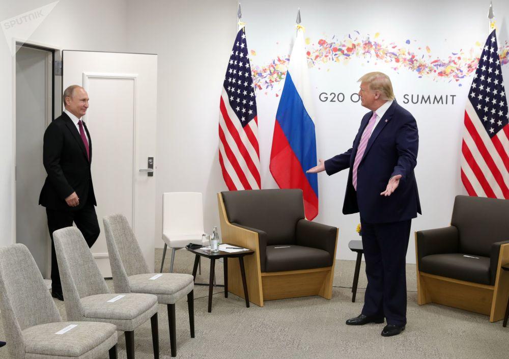2019年6月28日,俄羅斯總統普京和美國總統特朗普(右)在大阪舉行的G20峰會期間會晤。