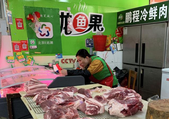 外媒:中國增加從美國進口大豆和豬肉